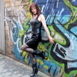 Latex Girl in seedy alley